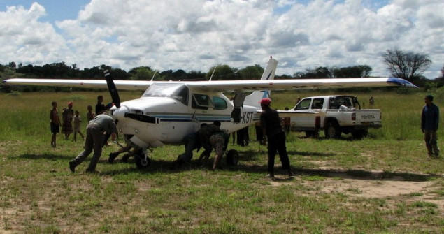In Tsumkwe everyone helps to turn plane around for take-off